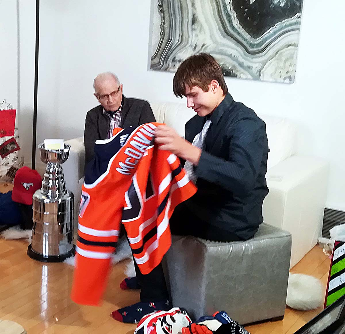 Peyton unveils his most prized collectible and keepsake – his Connor 'McDavid' NHL Oilers jersey.