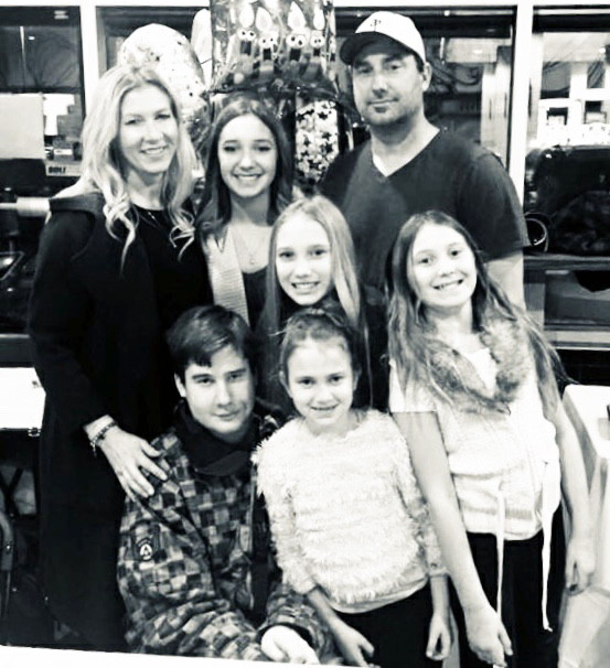 Peyton Kalbfleisch and family. Photo credit to Peyton Kalbfleisch and family: l to r, back row: Tracey, Paige, Chris. Kruise in middle, front row Peyton, Kourtney, Kadence. (Photo credit to Oilers Nation)Oilers Nation.